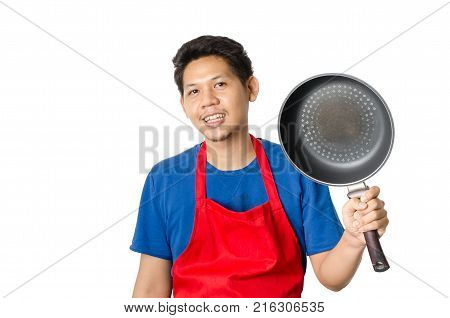 Asian man (Thai man) wear red apron and holding a pan for cooking isolated on white background
