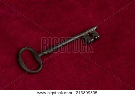 key on red velvet pillow