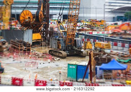 A Large Construction Site In The City, The Process Of Massive Buliding Construction With Heavy Vehic
