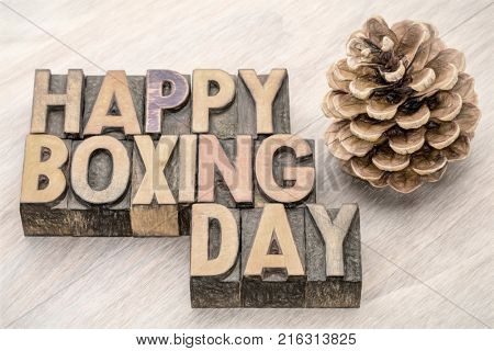 Happy Boxing Day word abstract in vintage letterpress wood type with a digital painitng filter applied