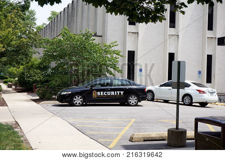 JOLIET, ILLINOIS / UNITED STATES - JULY 26, 2017: A patrol car, belonging to the University of Saint Francis Security Department, is parked in the parking lot of Marian Hall, on the campus of the University of Saint Francis.
