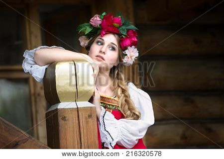 Russia, Moscow, Izmaylovsky Park, August 27, 2017. International Photo Festival.Beautiful woman portrait in russian style. Beautiful Russian girl in traditional dress. Russian style.