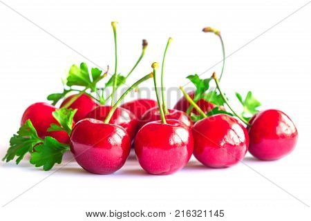 Fresh red cherries lay on white isolated background in side view, close up. Cherry have high vitamin C and have sweet and sour taste. Healthy and delicious fruit concept of red cherry.