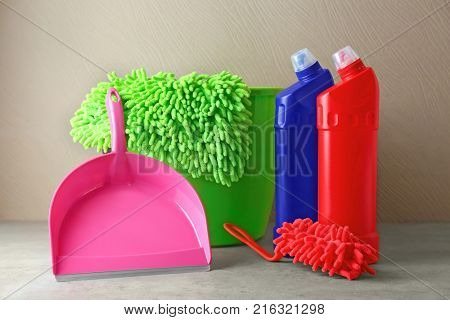 Cleaning supplies on color background