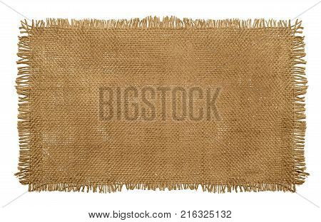 Burlap Hessian Sack material with worn frayed edges isolated on a white background