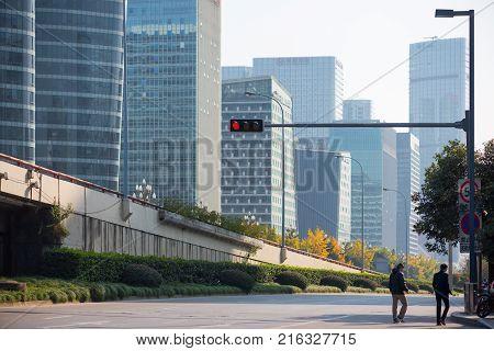 Chengdu, China - Nov 30, 2017 : Two chinese men walking in the High-Tech zone, south distric of Chengdu city