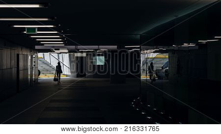 GIRL WITH SHOPPING IN THE UNDERPASS - Modern urban infrastructure for pedestrians