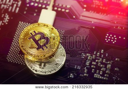Bitcoin. New virtual money. Bitcoins lie on the video card, concept of mining