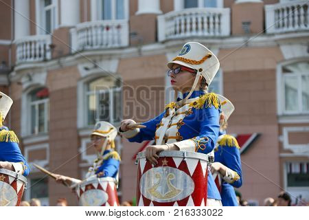 Belarus Gomel September 09 2017. Celebrating the city day.Belarus Gomel September 09 2017.A drummer in beautiful clothes with a drum. The drummer of a brass band
