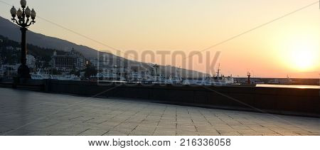 YALTA CRIMEA SEPTEMBER 18 2017: View of the morning embankment of the city of Yalta