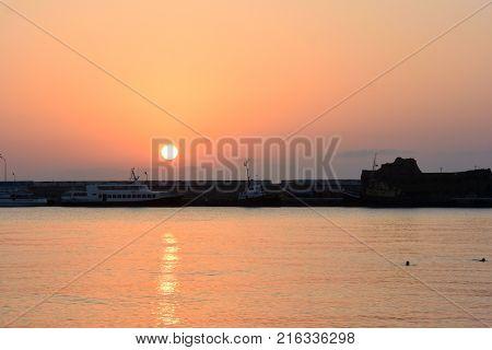 YALTA CRIMEA SEPTEMBER 18 2017: Sunrise over the port of Yalta