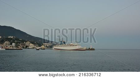 YALTA CRIMEA SEPTEMBER 13 2017: The port of Yalta after sunset