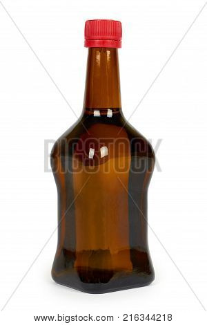 Glass bottle with soy sauce isolated on white background. Asian food.