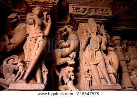 Details of interior of Lakshmana Temple in Khajuraho. Sculptures and relieves with mythological motives of Hinduism
