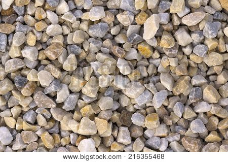Texture, pattern, background. marble chips for landscaping pebbles close-up samples, marble pebbles, a hard crystalline metamorphic form of limestone,