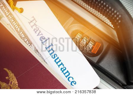 Travel Insurance tag on suitcase near numeric combination lockpassport and US Dollar. Travel Insurance is intended cover medical expensescover lost luggage flight cancellation or accident