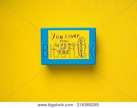 Blue box with concept card on yellow background. You never know where you will find the answer.