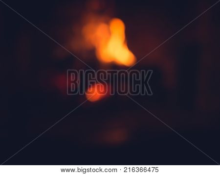 unfocused background of Burning wood in fireplace