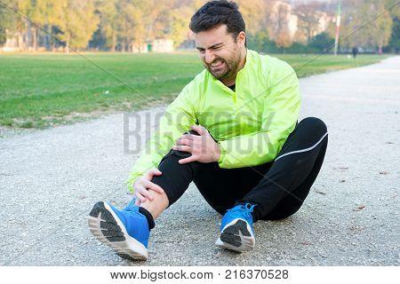 Knee Injury And Man Runner Exercising With Leg Pain