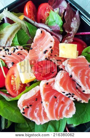 delicious slice of scalded salmon and salad poster