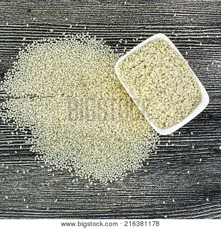 natural sesame seeds, sesame seeds, sesame seeds in plates, raw sesame seeds for cake and bread,