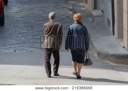 Elderly couple strolls. old sicilian couple. Europe, southern Italy, Sicily.