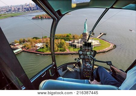 Helicopter flight view of Liberty Island and the famous Statue of Liberty monument symbol of New York City, United States.
