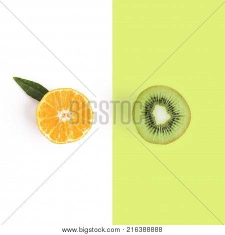 Food and fruit concept - cut of mandarine and kiwi. Top view or flat-lay. Copy space. Isolated on white with clipping path.