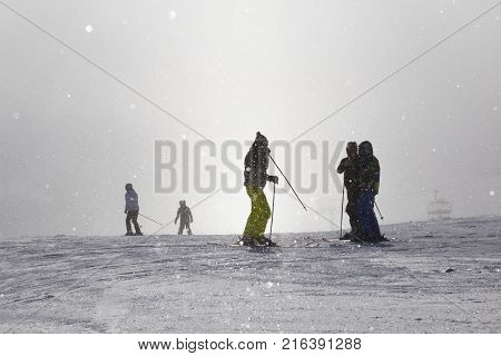 Skiers on ski chairlift in the fog. Strbske Pleso. High Tatras Mountains. Slovakia. Winter sport. Concept of leisure active healthy lifestyle winter entertainment