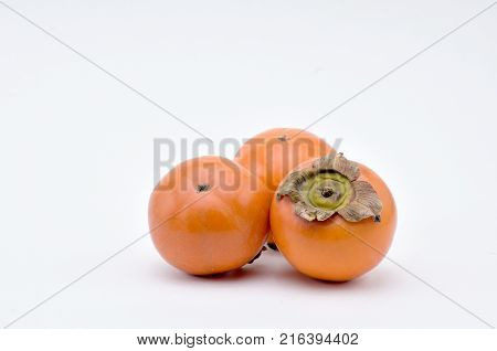 Persimmon southern fruit of orange-red colorsweet and astringent to taste.