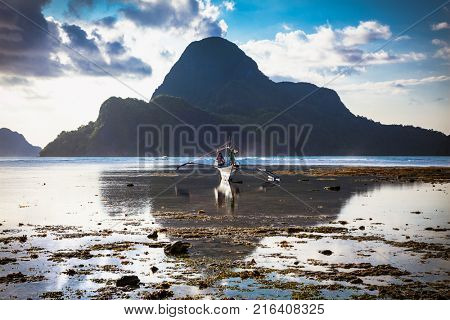 El NIDO, PHILIPPINES - MARCH 28, 2016.  Morning in the harbor fishing village El Nido on March 28, 2016 Palawan,  Philippines.