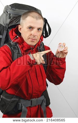 the a hiker with backpack holding a compass