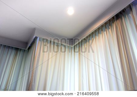 Ceiling Lamp Light And Nature Light Behind Fabric Curtain