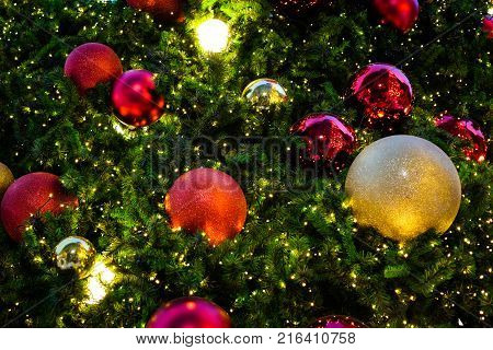 Colorful christmas tree with red & golden bell for background or texture - Merry Christmas and Happy new year 2018 concept.