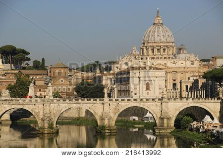 View of St. Peter's Basilica and the Tiber River from one of the bridges Rome Italy