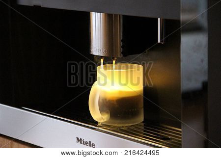 GERMANY - February 2016: Using Miele Built-In Coffee Machines for hot Americano in Germany