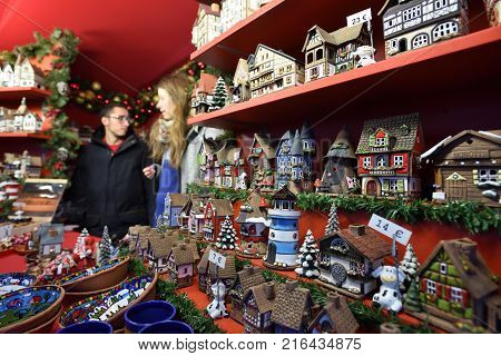 VILNIUS LITHUANIA - DECEMBER 02: Unidentified people trade souvenirsin annual traditional Christmas fair on December 02 2017 in Vilnius Lithuania.