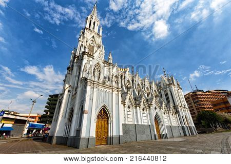 CALI, COLOMBIA - JUNE 11: Unidentified people walk past the Gothic La Ermita Church in Cali, Colombia on June 11, 2016.
