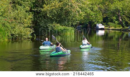 HEMMINGFORD GREY, CAMBRIDGESHIRE, ENGLAND,  AUGUST 28, 2017: People in canoes on the river ouse on a sunny day.