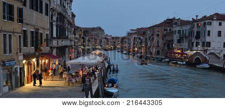 VENICE, ITALY - SEPTEMBER 23, 2017: Cannaregio Canal  early  evening with  illuminated restaurants and bars Venice.