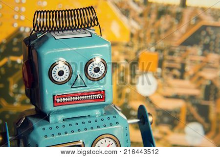 Vintage Tin Toy Robot Behind Computer Board, Artificial Intelligence Concept