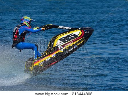WYBOSTON, BEDFORDSHIRE, ENGLAND -  APRIL 09, 2017: Jet Ski racer going over jump  at speed.