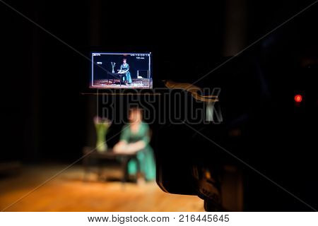 Filming performances of the actress or singer in the interior. A digital video camera. Color led display. The TV Studio.