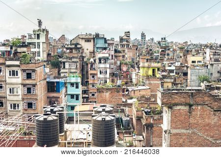 Cityscape of old clolorful multistorey houses in Kathmandu, Nepal. View from rooftop.