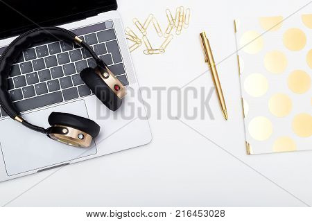 Headphones and keyboard on white background. Flat lay