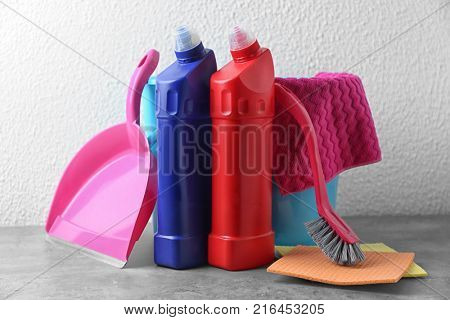 Cleaning supplies on light background