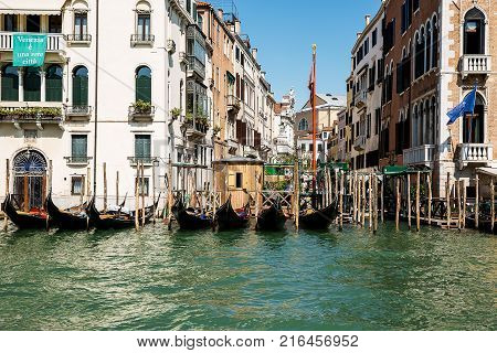 Beautiful photo of the Venetian canal with gondolas Italy .