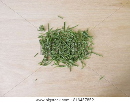 Dried field horsetail, equiseti herba, on wooden board