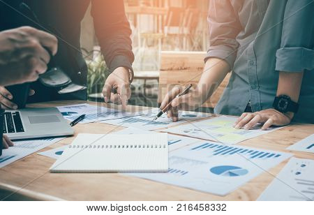 Businessman Writing Make Note On Paperwork Chart Summary Report Graph On Desk For Analyze Data.