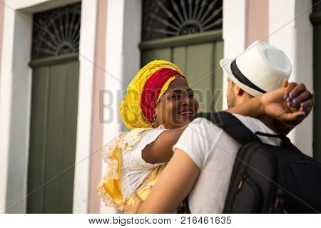 Tourist dancing with local Brazilian woman